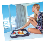 Woman relaxing on a private oceanview balcony.